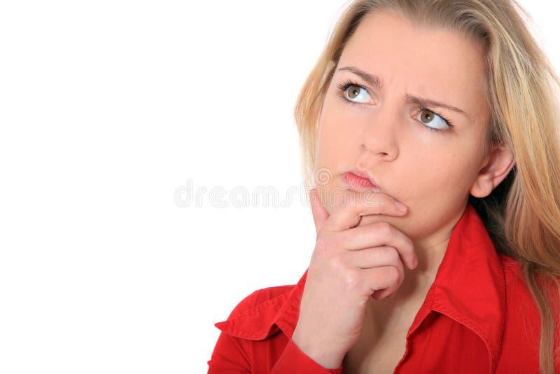 Młoda kobieta obmyśla decyzję fotografia stock