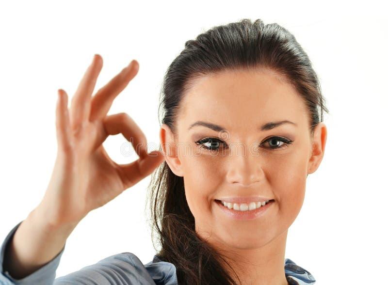 Młoda kobieta pokazywać biel isoleated na biel zdjęcia stock