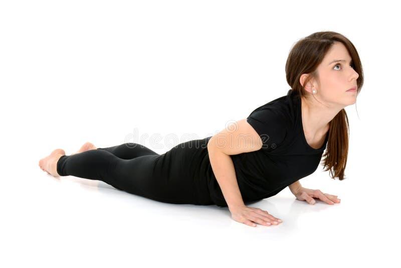 Młoda kobieta robi joga asana Bhujangasana kobry pozie zdjęcia royalty free