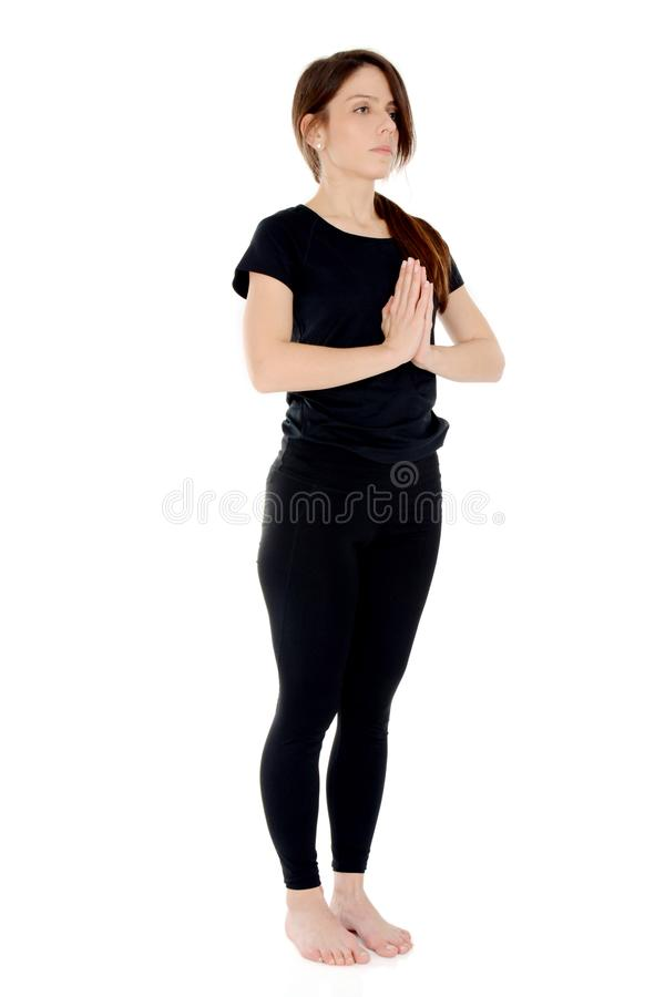 Młoda kobieta robi joga asana Namaste fotografia royalty free