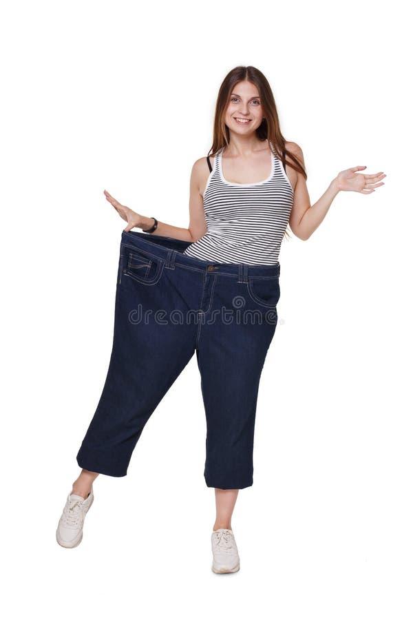 Młoda kobieta szczęśliwa ciężar straty dieta wynika, odizolowywał, fotografia royalty free