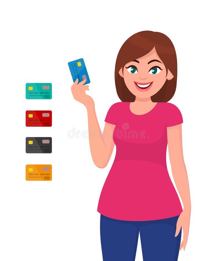 Młoda kobieta trzyma debetową furę i pokazuje kredytową kartę lub Bank royalty ilustracja
