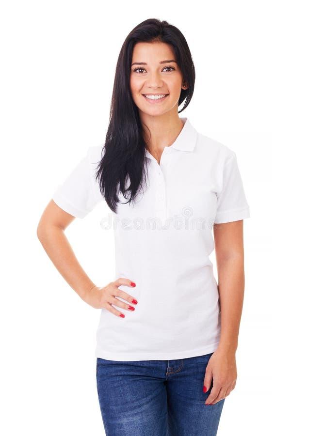 Młoda kobieta w białej polo koszula obraz royalty free