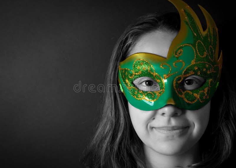 Młoda kobieta w masce fotografia stock
