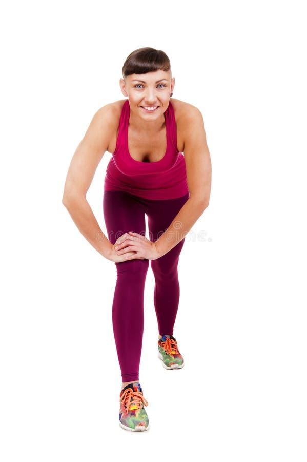 Młoda kobieta w sprawność fizyczna stroju treningu, odizolowywającym na białym backgr fotografia stock