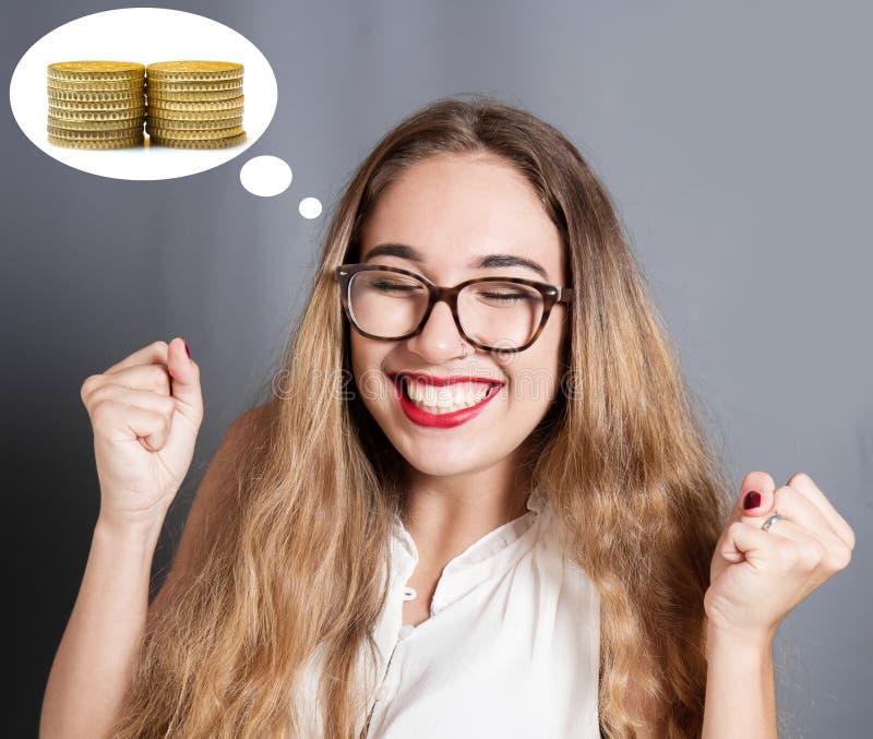 Młoda kobieta wyraża pragnienie mieć pieniądze zdjęcia stock