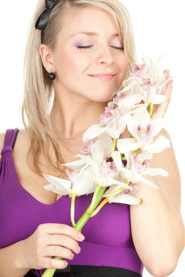 Młoda kobieta z biały orchideą fotografia stock