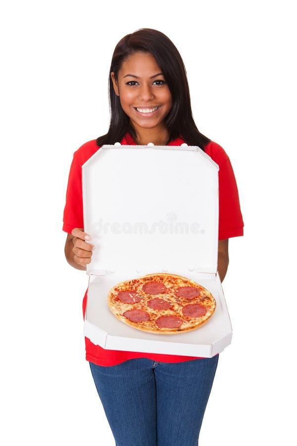 Download Młoda Kobieta Z Całą pizzą obraz stock. Obraz złożonej z osoba - 28969177