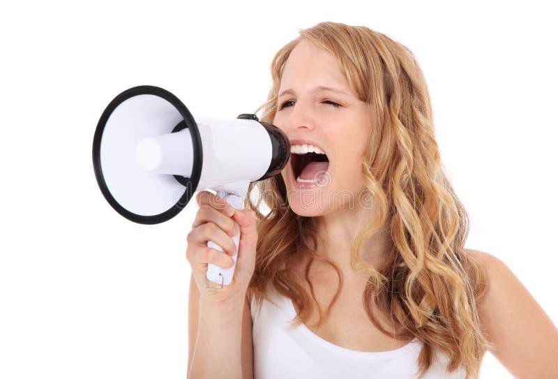Młoda kobieta z megafonem zdjęcia stock
