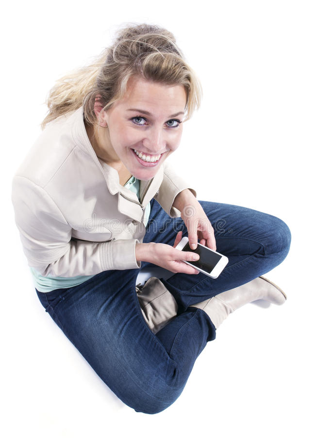 Młoda kobieta z smartphone zdjęcia royalty free