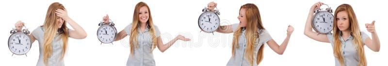 Młoda kobieta z zegarem na bielu obraz stock