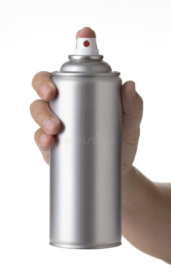 Młoda męska ręka rozpyla aerosolowej kiści farbę może fotografia stock
