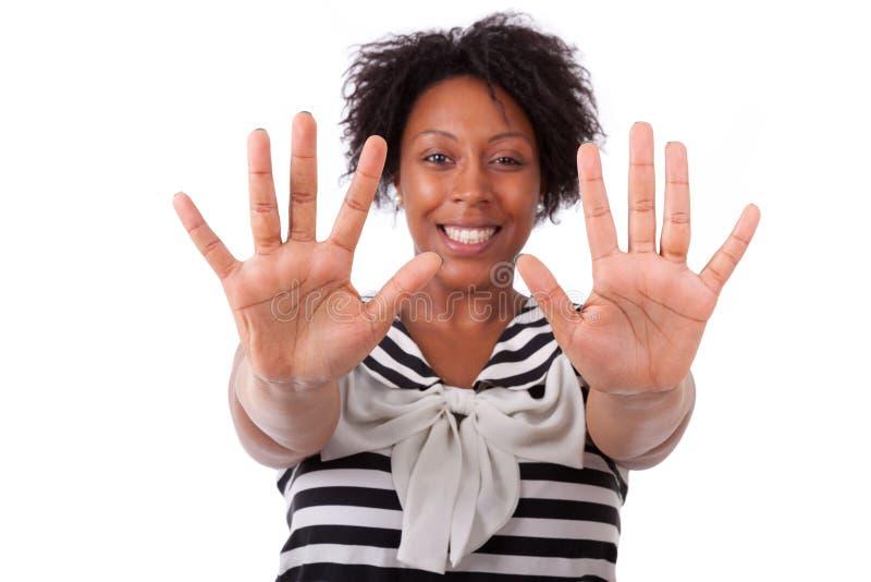 Młoda murzynka pokazuje ona ręki palmy - Afrykańscy ludzie obrazy royalty free