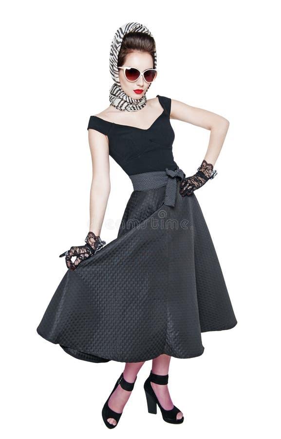 Młoda piękna kobieta w retro szpilki up stylowy pozować odizolowywam fotografia stock