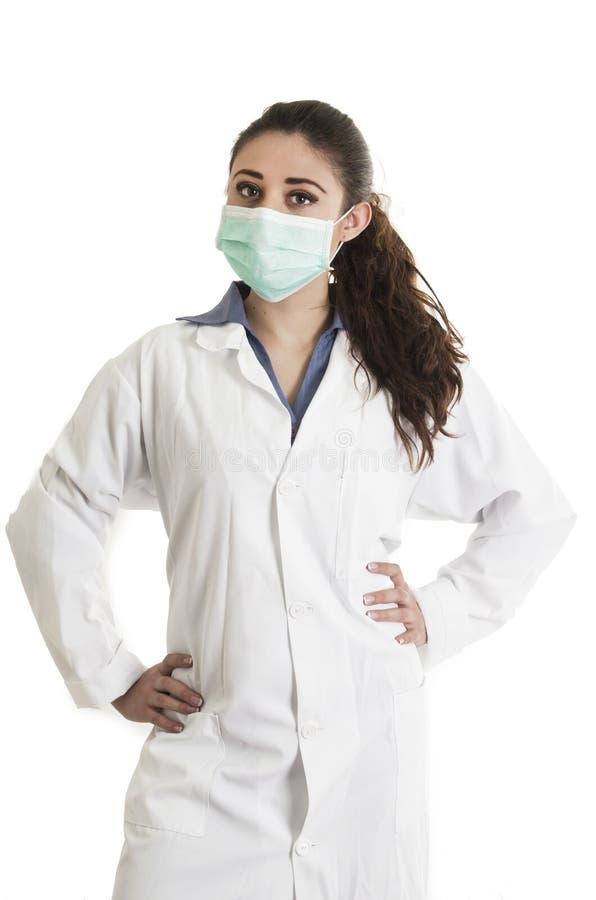 Młoda piękna kobiety lekarka jest ubranym maskę fotografia royalty free