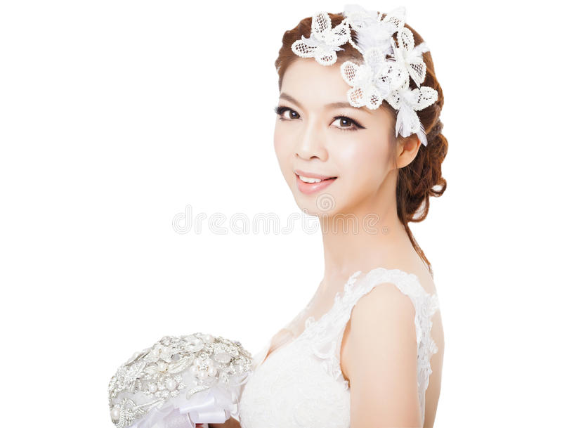Młoda piękna panna młoda z kwiatami fotografia royalty free