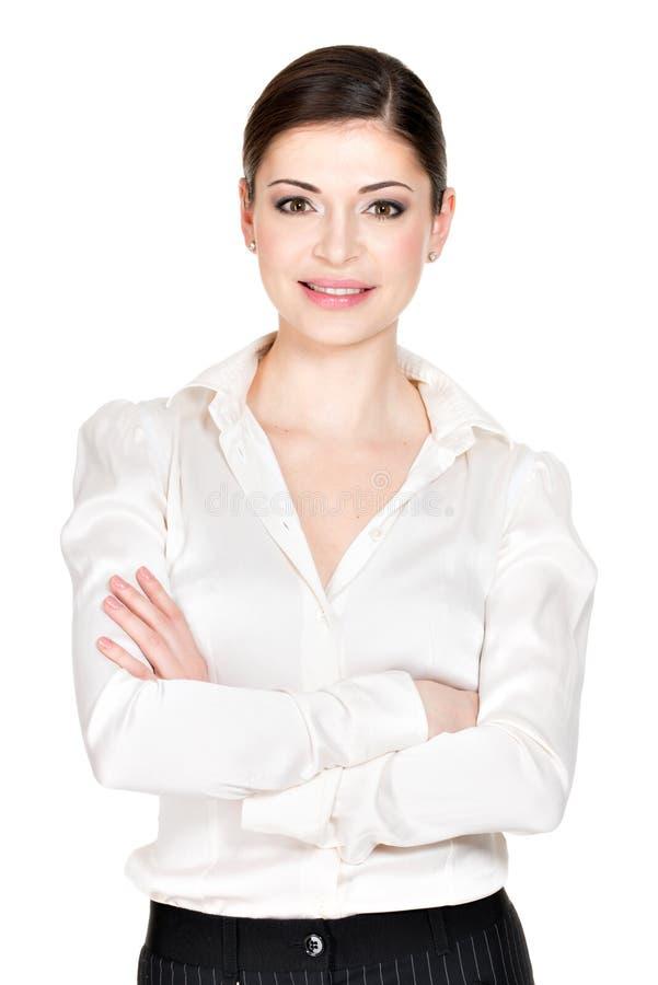 Młoda piękna uśmiechnięta kobieta w białej biurowej koszula zdjęcie stock