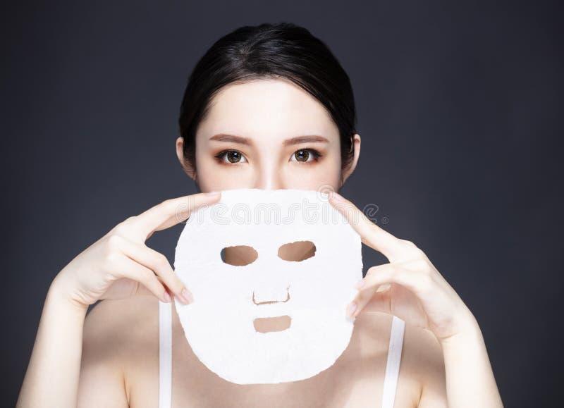 Młoda piękno twarz i twarzowa maska obraz royalty free