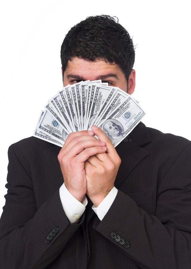 Młoda pomyślna biznesmena mienia sterta pieniądze zdjęcie royalty free