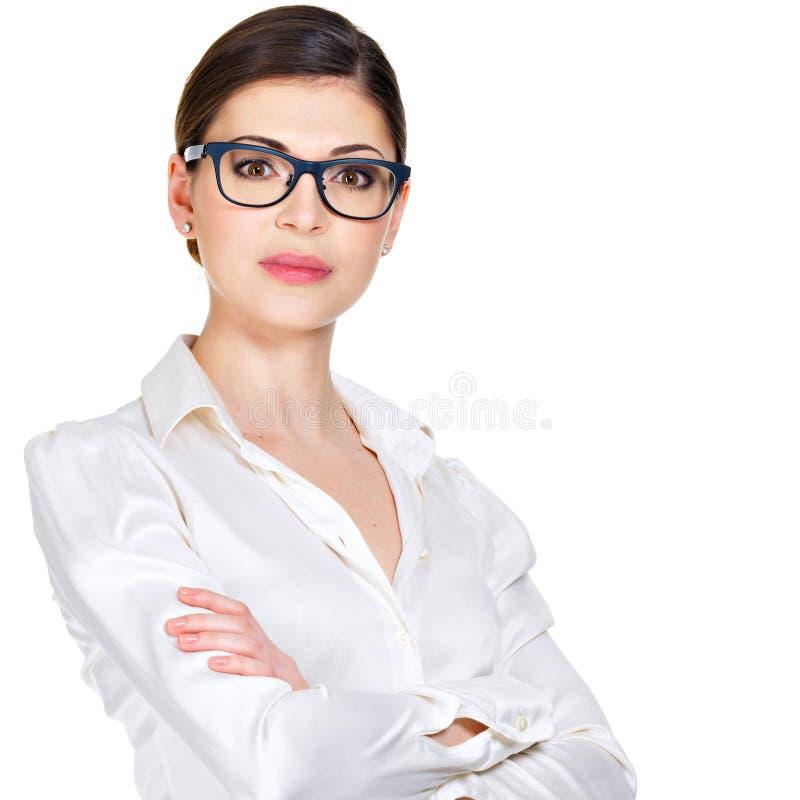Młoda poważna kobieta w szkłach i białej koszula obrazy stock