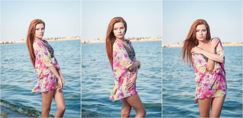 Młoda seksowna czerwona włosiana dziewczyna w stubarwnej bluzce pozuje na plaży Zmysłowa atrakcyjna kobieta z długie włosy, lato  fotografia stock