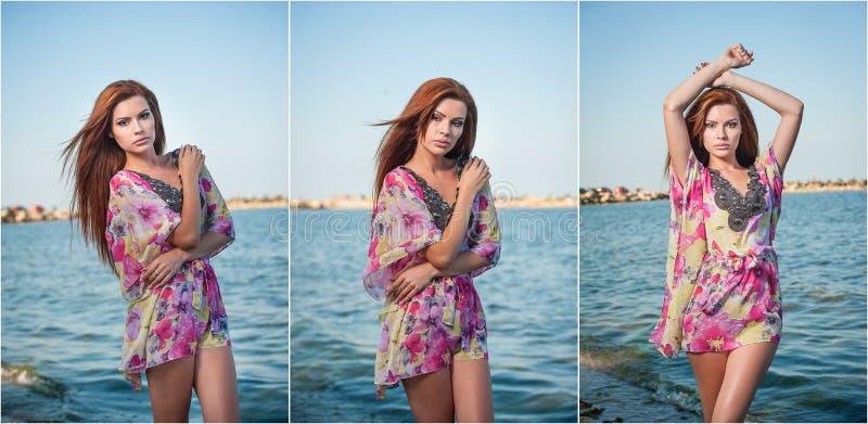 Młoda seksowna czerwona włosiana dziewczyna w stubarwnej bluzce pozuje na plaży Zmysłowa atrakcyjna kobieta z długie włosy, lato  obrazy stock