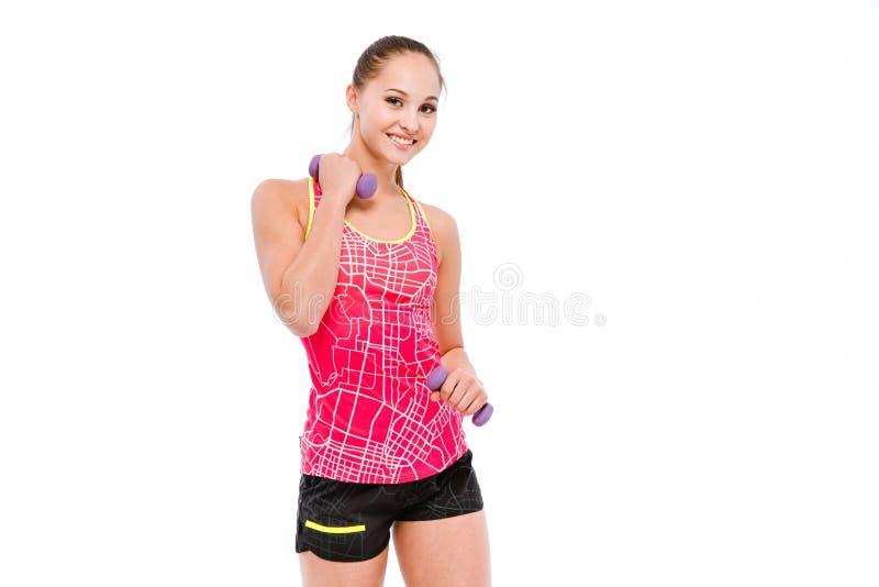 Młoda sportsmenka ćwiczy z dumbbells fotografia stock