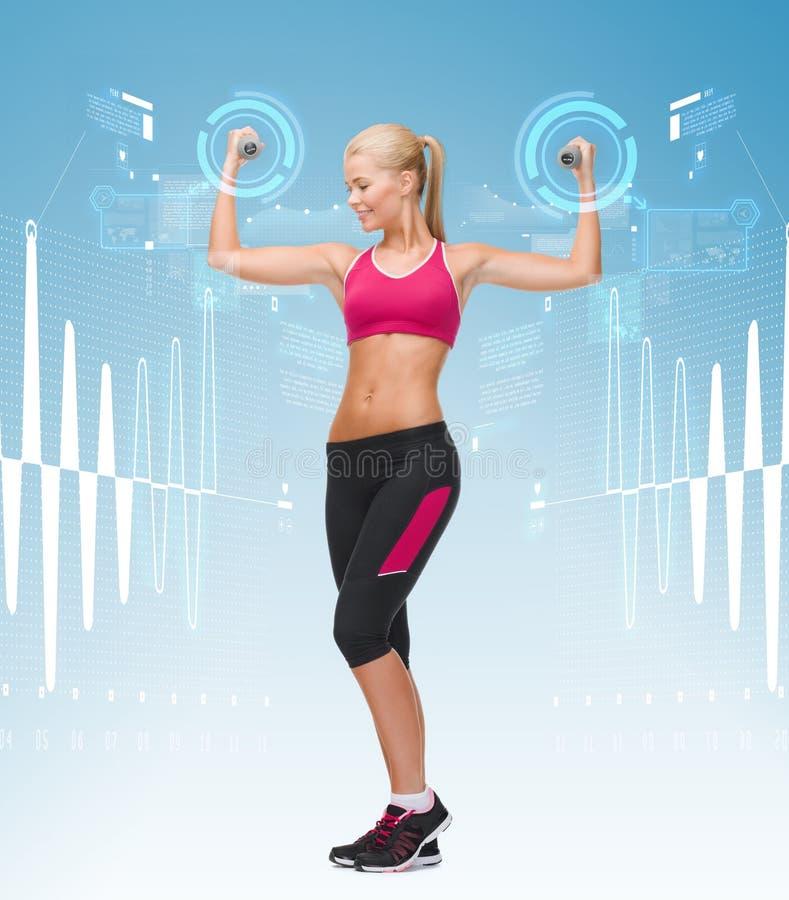Młoda sporty kobieta z lekkimi dumbbells zdjęcia stock