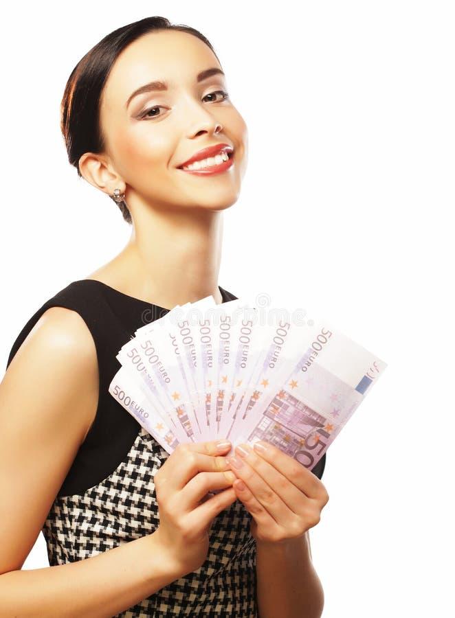 Młoda szczęśliwa kobieta z dolarami w ręce Odizolowywający na białym backgr obraz stock
