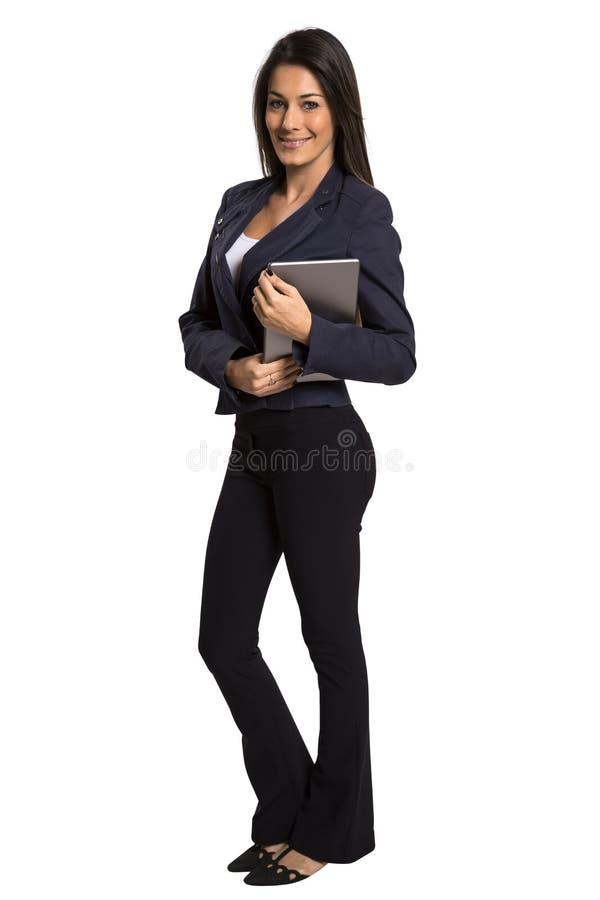 Młoda uśmiechnięta biznesowa kobieta z pastylka komputerem zdjęcie royalty free