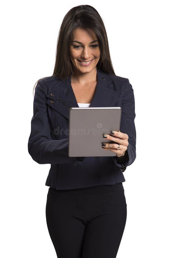 Młoda uśmiechnięta biznesowa kobieta z pastylka komputerem zdjęcia royalty free