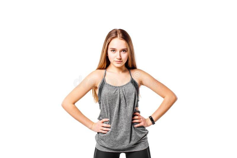 Młoda ufna sprawności fizycznej dziewczyna odizolowywająca na bielu obraz stock