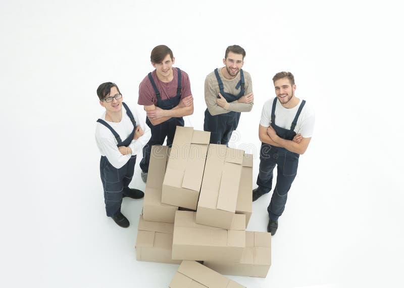 Młode wnioskodawcy trzyma pudełka odizolowywają na białym tle, fotografia royalty free