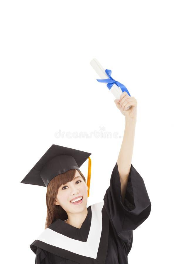 Młodego absolwenta dziewczyny ucznia mienia dyplom up i ręka zdjęcie royalty free