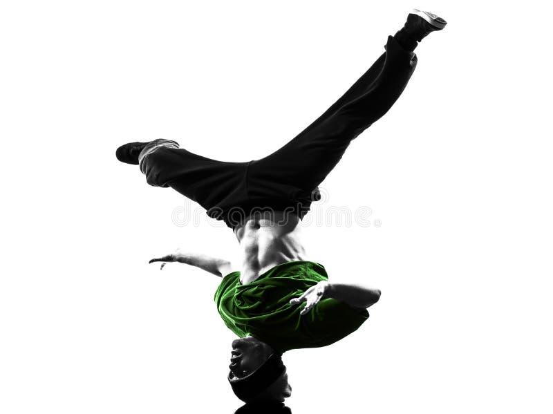 Młodego akrobatycznego przerwa tancerza mężczyzna breakdancing sylwetka obraz stock