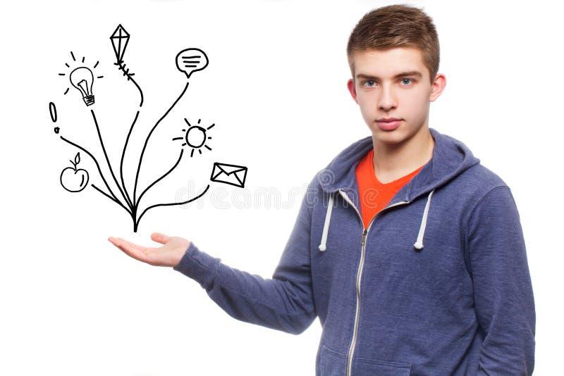 Młodego chłopiec przedstawienia latające rzeczy w powietrzu fotografia stock
