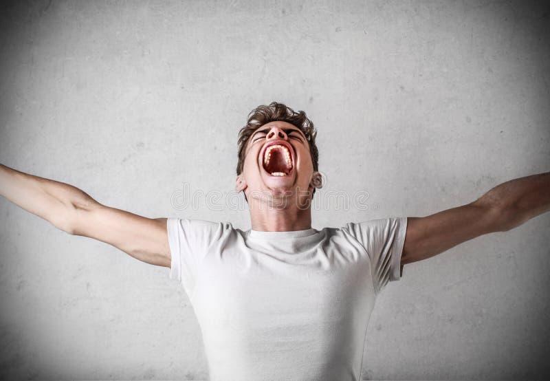Młodego człowieka krzyczeć zdjęcia royalty free