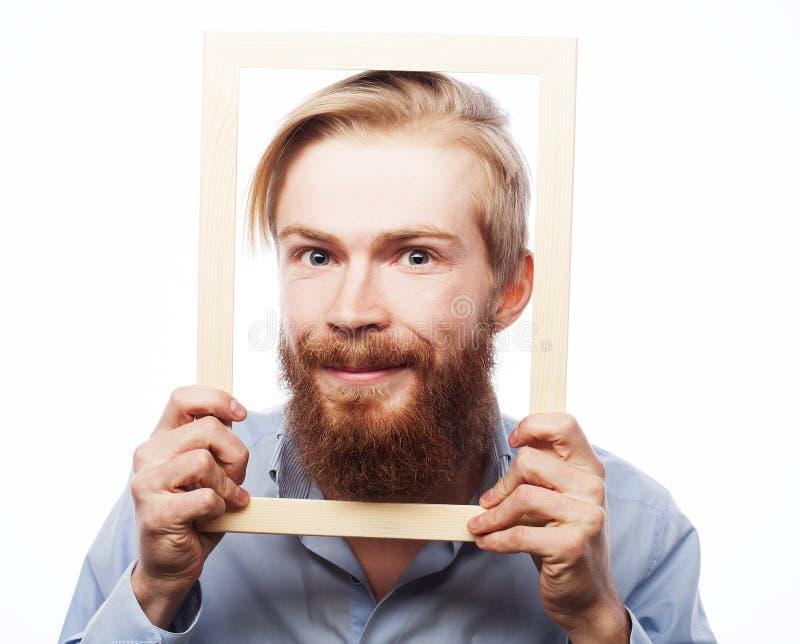 Download Młodego Człowieka Mienia Obrazka Rama Zdjęcie Stock - Obraz złożonej z mężczyzna, ludzie: 53787930