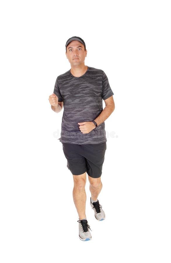 Młodego człowieka szkolenie jogging w studiu zdjęcia stock