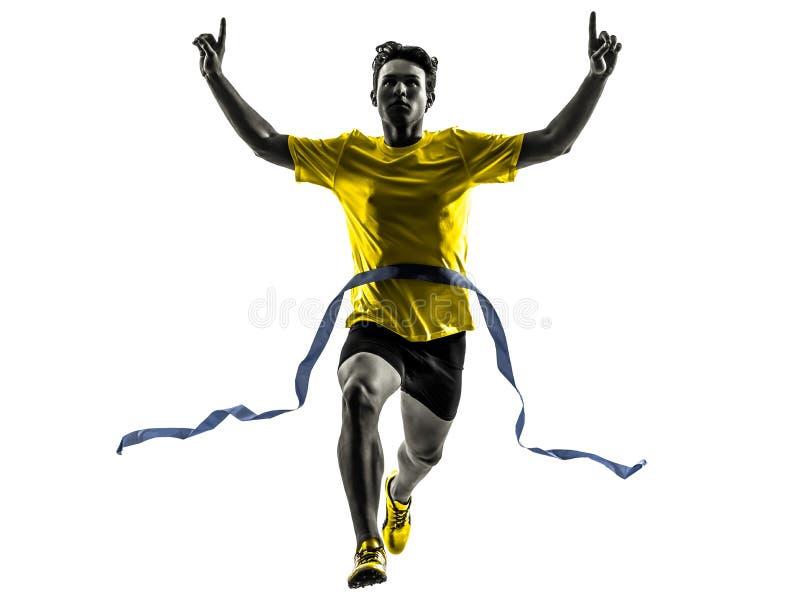 Młodego człowieka szybkobiegacza biegacza zwycięzcy mety działająca sylwetka fotografia royalty free