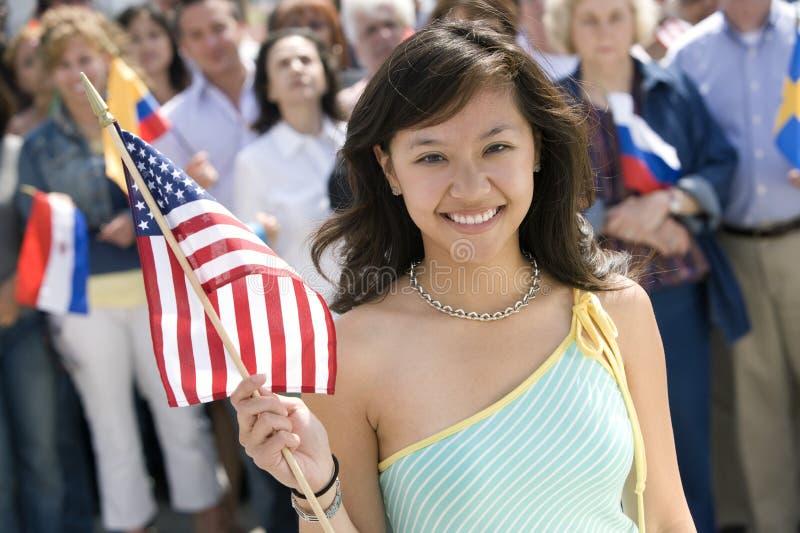 Młodej Dziewczyny mienia flaga amerykańska obraz stock