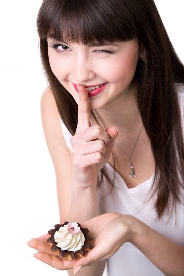 Młodej kobiety łasowanie w sekrecie obraz stock
