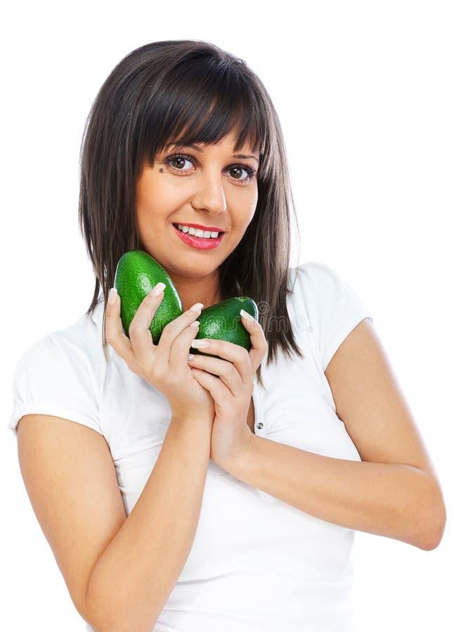 Młodej kobiety mienia avocado zdjęcie stock