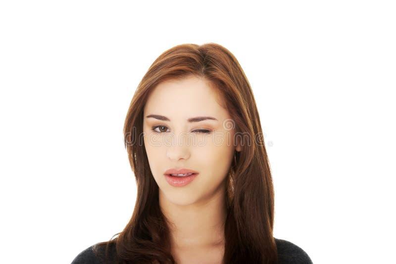Młodej kobiety mrugnięcia oko obrazy royalty free