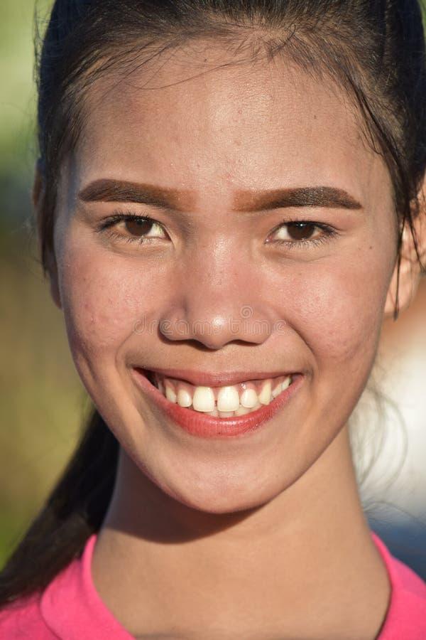 Młody żeński ono uśmiecha się zdjęcie royalty free