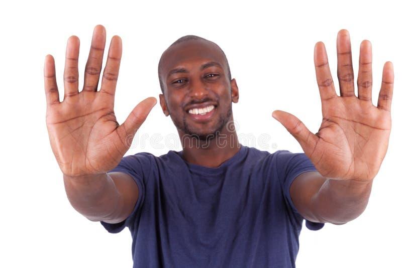 Młody amerykanina afrykańskiego pochodzenia mężczyzna jego wręcza palmy zdjęcie royalty free