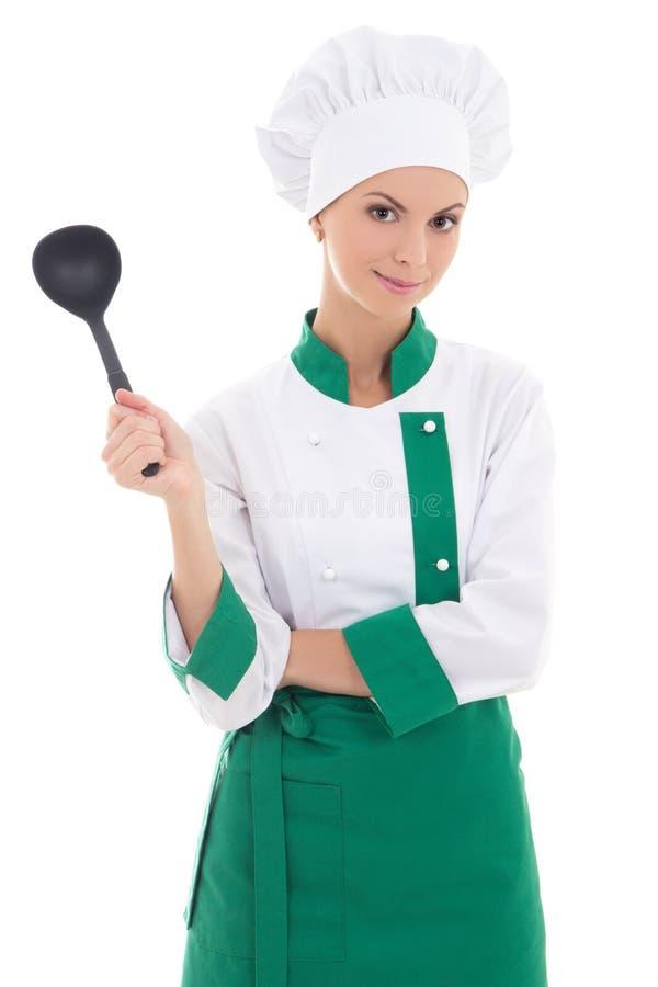 Młody atrakcyjny kobieta szef kuchni z dużą plastikową łyżką odizolowywającą na w obraz stock