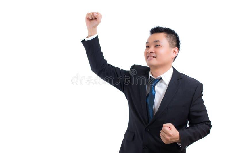Młody Azjatycki biznesmena świętować Pomyślny Biznesmen szczęśliwy i uśmiech z rękami up podczas gdy stojący fotografia stock