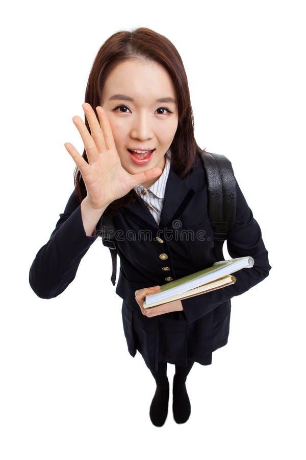 Młody Azjatycki uczeń mówi coś wysoki kąta strzał zdjęcia stock