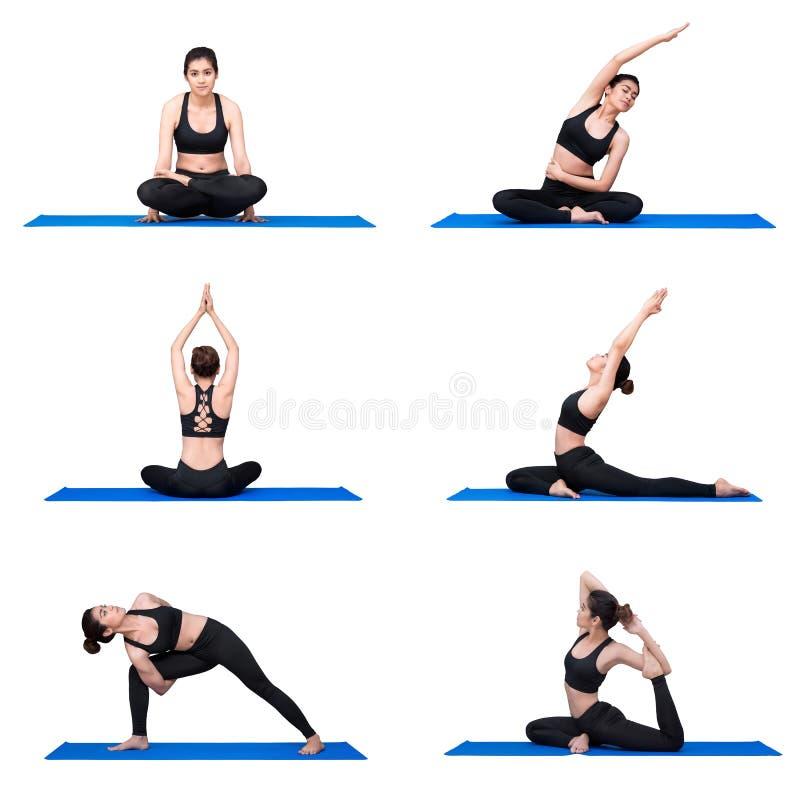 Młody azjatykci kobiety praktyki joga pozy ćwiczenie przy joga sporta gym fotografia stock